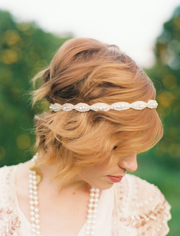 Let your hair lay natural or give it loose waves and place a headband over all of it including the bangs .