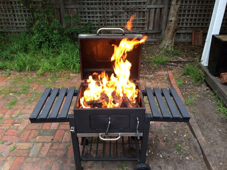 Burning the wood to create the coals