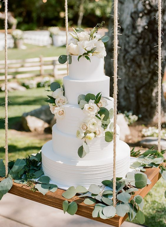 30+ Greenery Wedding Ideas That Are Actually Gorgeous---swing wedding cake with floral and greenery, outdoor weddings, woodland or garden wedding theme