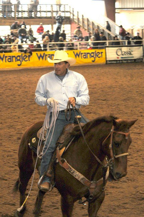 George Strait. Great lookin horse, great lookin man! :D Even if he is like 60 and retiring. :(