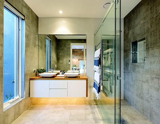 I like the way the tiles run across into the shower and makes the fact the mirror does not run to the ceiling not look out of place.