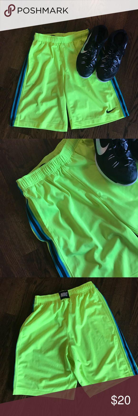 Nike basketball  shorts Nike basketball shorts like new condition. Bright yellow, drawstring waste, pockets. Nike Shorts Athletic