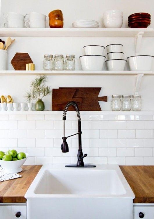 Open shelves, subway tile. Small farmhouse sink