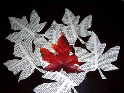 Making Fall Leaves of Paper (could do a large tree with book leaf pages for a fall bulletin board display, use sizzix for leaves and have kids paint with watercolors)