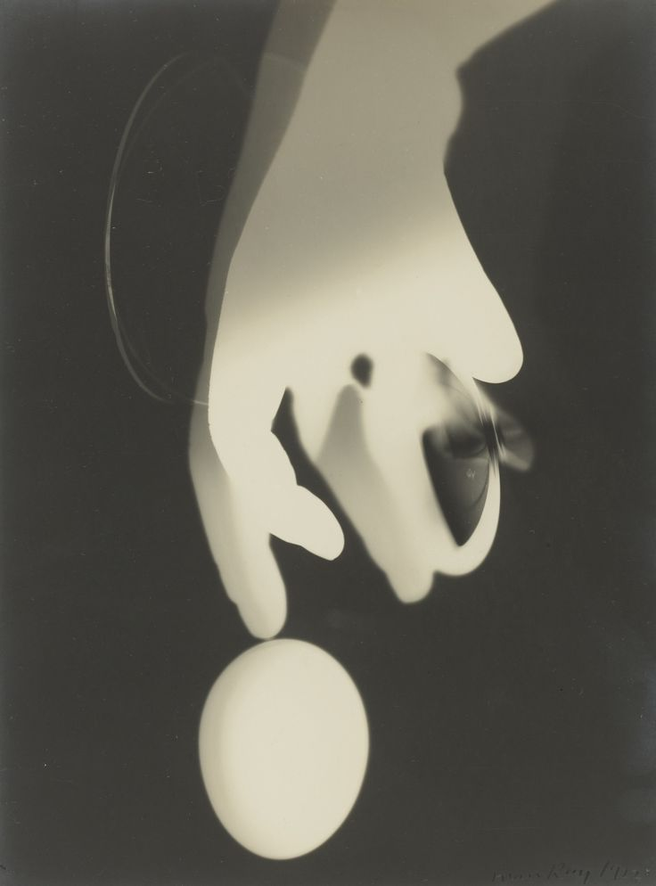 MAN RAY  RAYOGRAPH WITH HAND, LENS, AND EGG