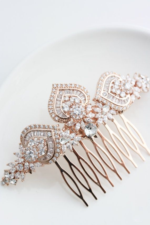 This gorgeous wedding wedding hair comb has been handcrafted by me using sparkling Cubic Zirconia Components, Vintage brass Stampings and settings and Swarovski Crystal. I have made the base line straight so it can be worn along a low bun, tucked in a french roll, or slipped over a veil to be worn as a veil slide …. so many options! It a really nice size too, 4 ½ inches long, and its art deco styling will give very sophisticated impact.  I can make this in All Crystal, or with a touch of…