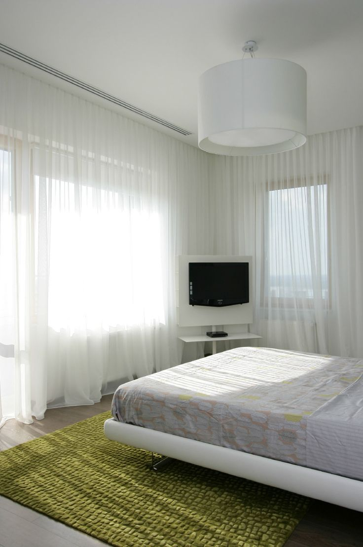 Apartments:Glamorous Beedroom With White Modern Bed White Pendant Lamp Slim Television Also Near Windows Plus White Curtains Also Yellowish Green Carpet For Modern Apartment Living Room Ideas Glowing white Interior Design Ideas for Modern Apartment Living Room Ideas