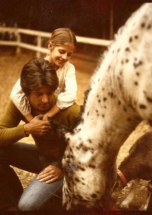 """Rick Nelson with his daughter Tracy.  (He loved animals.) Tracy recently shared this image on Facebook and had this to say: """"with Pop and Moon aka Houdini and Missy the goat"""""""