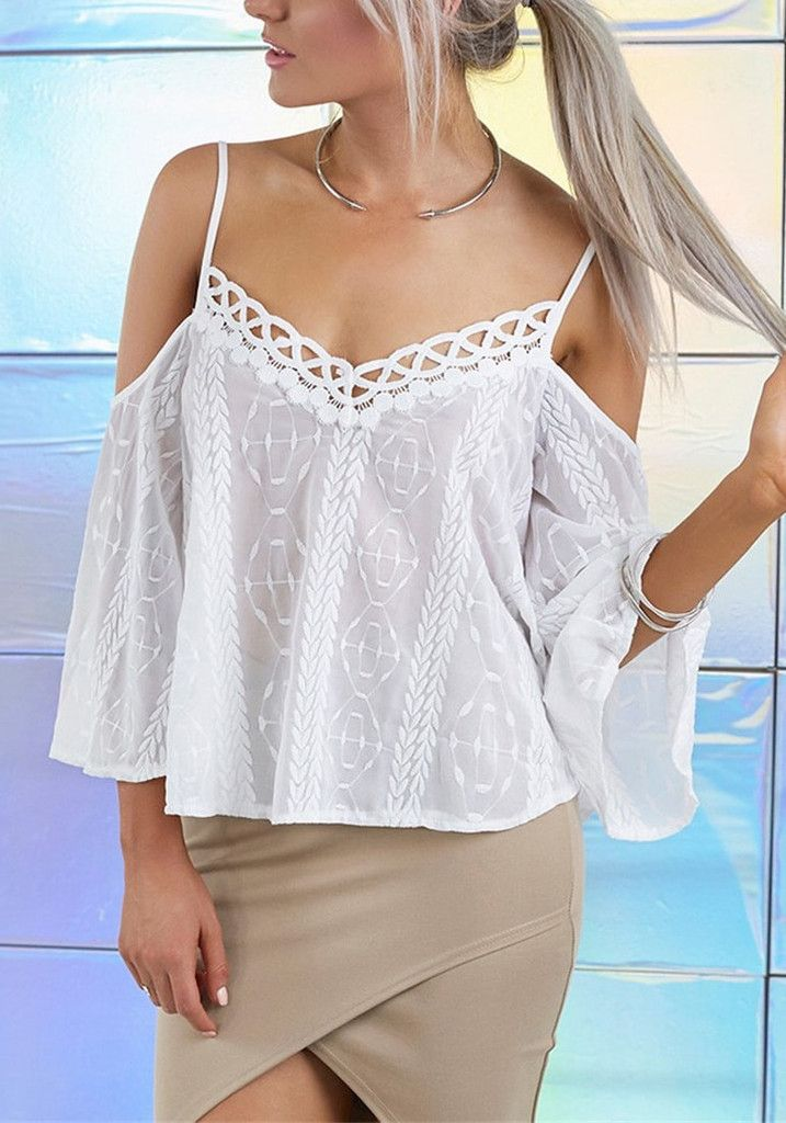 We all love a sweet, breezy top like this white embroidered chiffon cold-shoulder top!