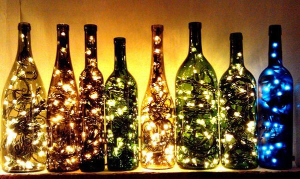 Empty wine bottles uses as a light display.....this is just the right decor for our outdooor kitchen.....ok, now to empty some wine bottles!