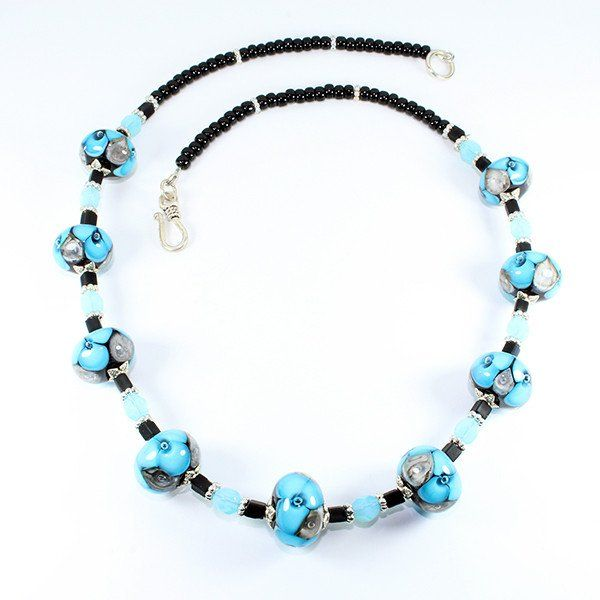 Seaviolet Turquoise Murano Glass Beaded Necklace that represents the essence of the Seaviolet Flower. Hand crafted using centuries old Murano glass lampwork techniques. Length:50cm Every piece is unique and may differ slightly from the image displayed.