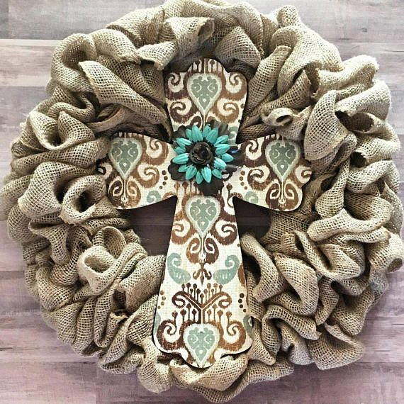 Beautifully full burlap wreath adorned with 16 wooden cross. Wreath measures 20 across.