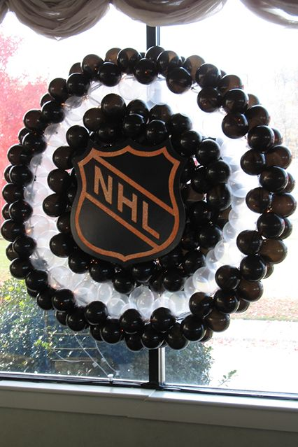 NHL Hockey Puck Balloon Sculpture