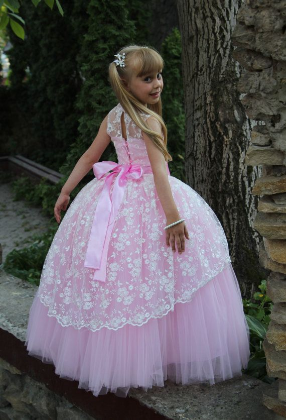 Gorgeous lace flower girl dress with multilayered skirt, corset with zipper and atlas ribbon.   Item material: upper layer of the skirt- guipure