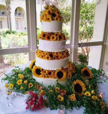 Sunflowers and roses -organic design was top award winner on Florist Review Picture Perfect weddings