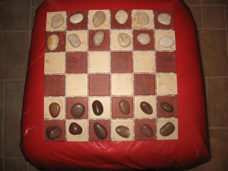 "home made checker board! using rocks and 12"" x 12"" back splash"