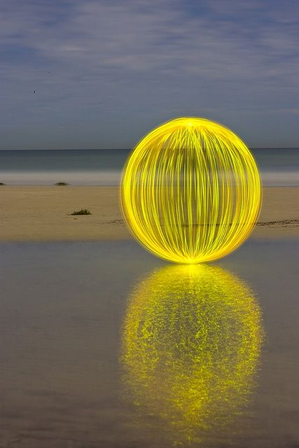 land art installation acid yellow light sphere