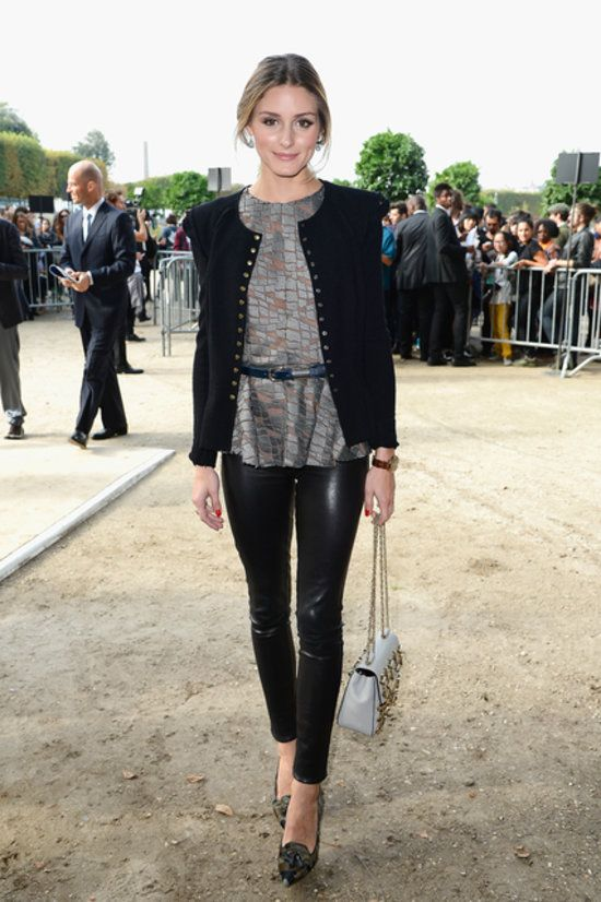 in a shimmering top, strong-shouldered jacket, and pair of ultraslick leather leggings.