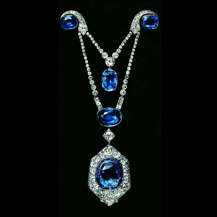 """Broche draperie, Cartier Paris, 1913, platinum, gold, old-cut round diamonds, five cushion-shaped sapphires for a total weigh of 39,66 carats, faceted and calibrated sapphires, millegrain set and close set. Origin: Marie-Emilie, countess Esterházy. Cartier named """"broche draperie"""" those pendant brooches formed by two elements joint together by a pin, to which the pendant would be suspended, originally a """"guirlande"""" style drape. #belleépoque"""