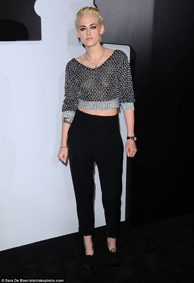 Edgy: Kristen Stewart showed her alluring edge in a chainmail crop top and black trousers at the Chanel No 5 L'Eau Dinner in Los Angeles on Thursday