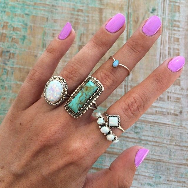 Turquoise rings and pink manicure