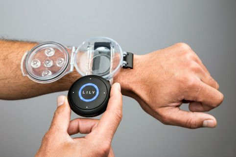 The Lily's round tracker can go in your pocket, or in a case on your wrist.