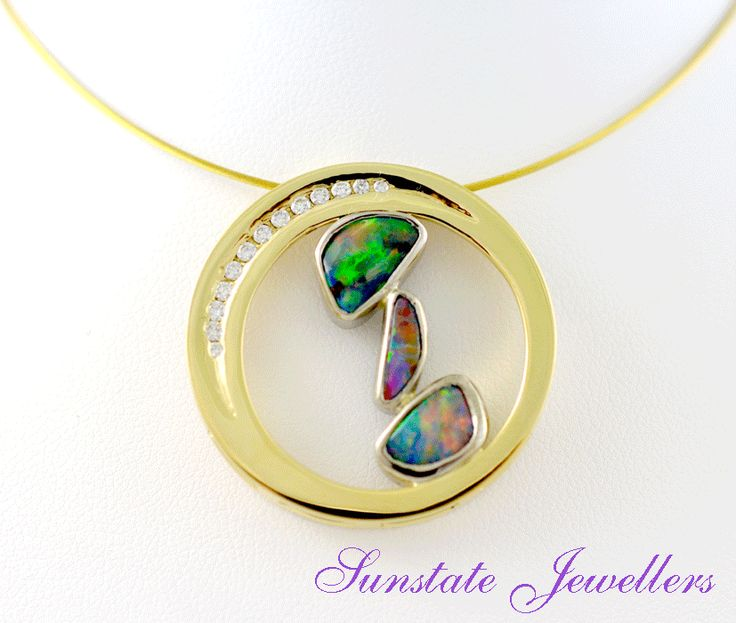 Three boulder opals from the Alaric mine in Queensland in an 18ct yellow gold circle pendant with 12 natural brilliant cut diamonds