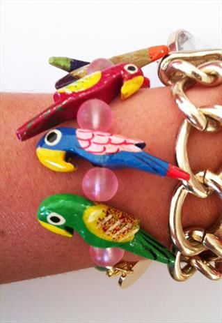 The Parrots. Hand painted wooden parrot bead bracelet from Shh by Sadie on ASOS Marketplace.