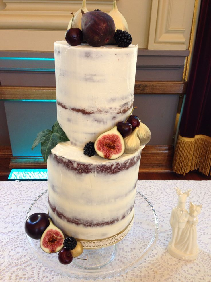 8 tier buttercream frosted cake for Jess and Tims summer wedding at Albert Hall