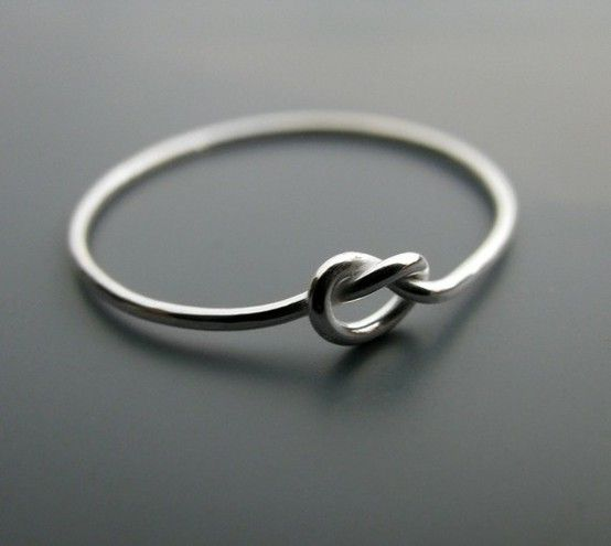 """thecrazyfilipino:    A """"knot"""" ring. The ring symbolizes a knot that is not quite tied yet, but has all intentions of being tied. A promise ring."""