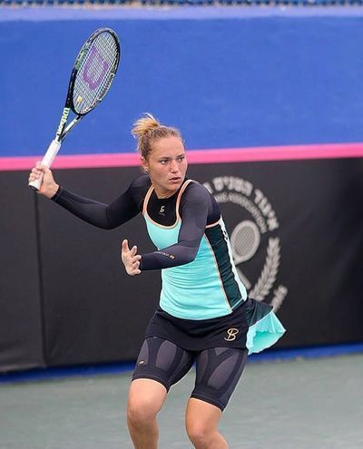 Pro tennis player, Katerina Bondarenko, wearing our #Enerskin Shorts and Long-Sleeve. #Tennis #Compression