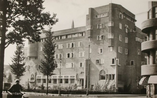 1940 's. View on the Roelof Hartplein with Huize Lydia in Amsterdam. Huize Lydia was originally a house for single girls, but also unmarried men and nurses who worked in the Onze Lieve Vrouwe Gasthuis. The building was designed by Jan Balaraman and built between 1924 and 1927 in the style of the Amsterdam school. Today the property is owned by housing corporation Ymere and is operated as a multi-functional center with one and two bedroom apartments. #amsterdam #1940 #RoelofHartplein…