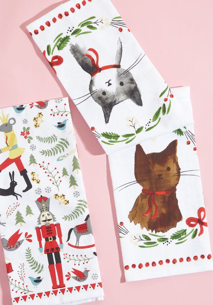 Holly Jolly Home Tea Towel Set - Let your holiday spirit come to life in the kitchen with these white tea towels! Instantly upping the festive factor of your galley decor with a Nutcracker-inspired pattern on one towel and a print of quirky, wreath-framed kitties on the other, this duo keeps the yuletide vibe alive.