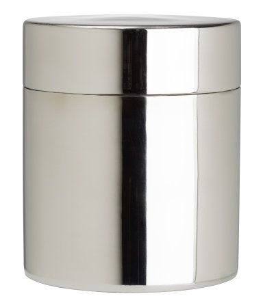 Metal box with lid. Diameter 3 1/4 in., height 4 in. Color can vary slightly from product to product.