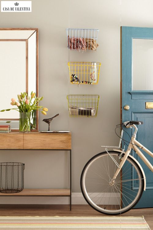 clean entryway.  love the wire baskets for organization.