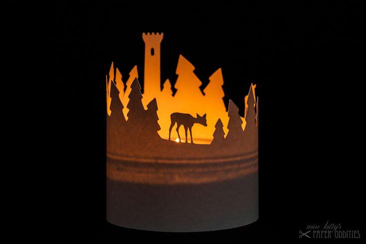 construction paper for a little lantern.winter landscape with deer.