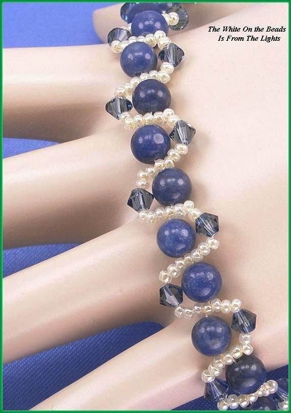 """Jewelry is made with small beads. Some are glass or stone. Adult supervision is recommended. This bracelet is made with Miyuki 11/0 white glass seed beads along with 4mm denim blue Chinese crystal bicone glass beads and, is accented with 6mm round Brazilian blue Sodalite gemstone beads and hooks with a lobster claw clasp. Measures approx. 8 1/2"""" long (including clasp) by 1/2"""" wide and is a design pattern from: Korean Design. Priced at only $27.50 with """"FREE"""