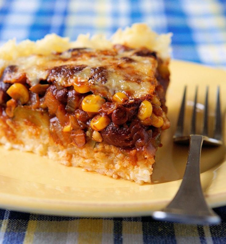 Rice crust filled with fried zuchinni, red bean chili and cheese. http://www.cautiousvegetarian.ca/recipe/tamale-pie/