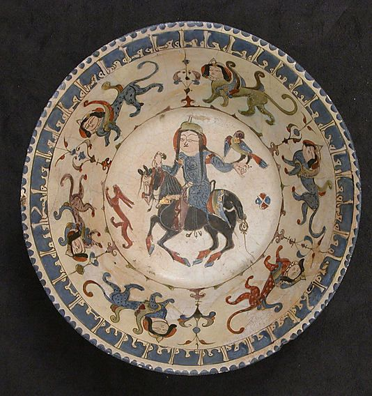 Bowl    Date:      12th–13th century  Geography:      Iran  Medium:      Stonepaste; polychrome in-glaze and overglaze painted with gilding on an opaque white glaze (mina'i)  Dimensions:      H. 3 1/2 in. (8.9 cm) Diam. 8 1/4 in. (21 cm)  Classification:      Ceramics
