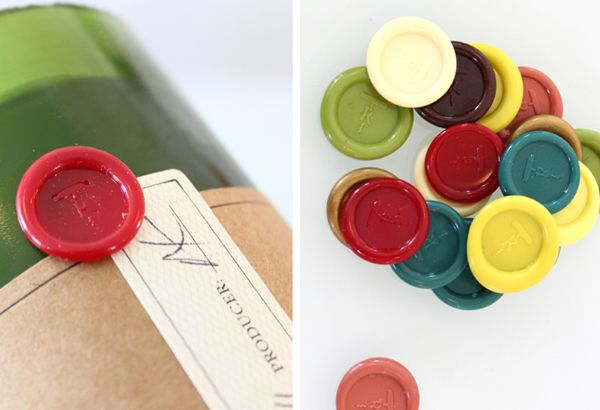 Packaging with wax seal, sticker and unbleached paper details created by Stitch for soy wax candle brand Rewined