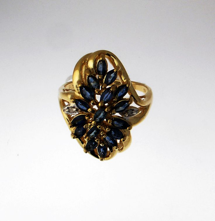 Stunning Marquis Sapphire cluster ring with diamond accents and 14k yellow gold. Comment or email jeff@premiergems.ca for details. -SOLD-