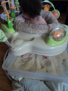Sensory activities for infants and babies. Put a sensory bin under a jumper and let baby kick and play in it with their feet. More ideas for sensory play for babies on site