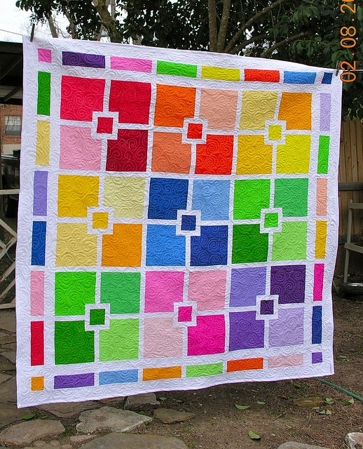 fun quilt! Could be fun to match some coordinating prints for the larger squares and keep the smaller square & border as solids?
