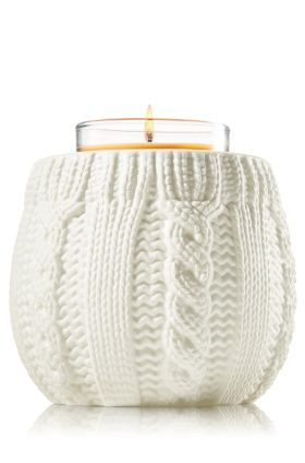 Ceramic Cable Knit Mini Candle Holder. So cute. I put a matching white colored mini-candle in it (marshmallow fireside).