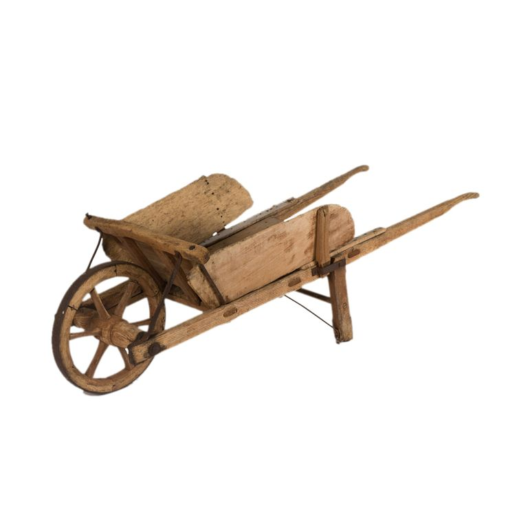 Griggs Wheel Barrow at Found Vintage Rentals. Rustic wooden cart