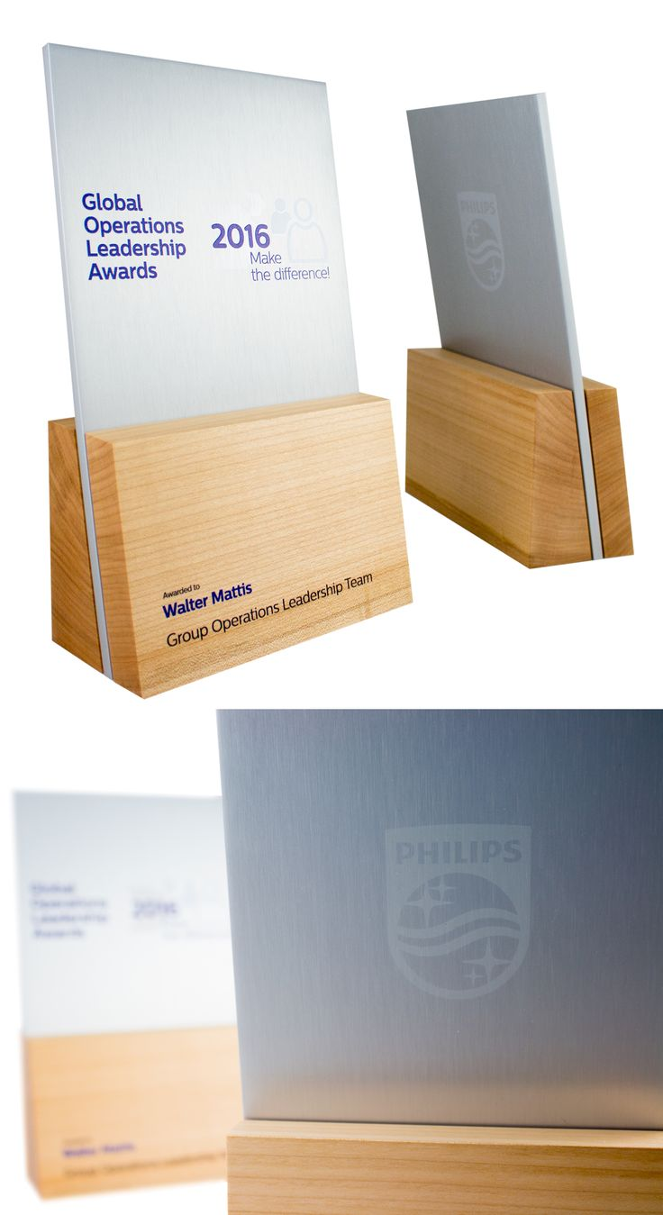 Custom trophies / awards for Philips in the Netherlands. Handcrafted from aluminum and recovered Maple wood. Modern design and beautiful materials.