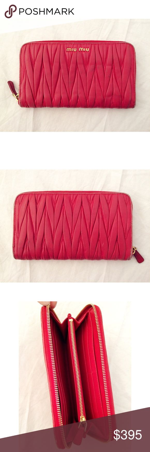 """Miu Miu Matelasse Zippy Wallet Miu Miu matelasse gathered buttery soft nappa leather zip around zippy wallet.  Preowned; shows signs of wear along the edges.  True red color with gold logo / zipper.  Measures 7.5"""" x 1"""" x 4.5"""".  No trades.  {box35} Miu Miu Bags Wallets"""