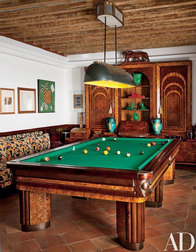The billiard room's 17th-century ceiling hosts a Rovatti pendant light