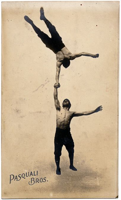 The muscular Pasquali Brothers were one of many strongman acts on the British music hall circuits. Combining their power with acrobatic skills must have increased their popularity. (1890)