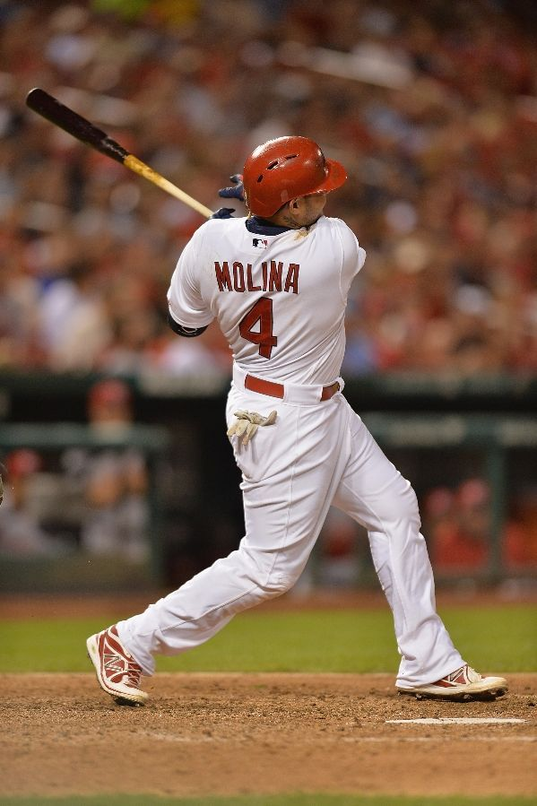 ST. LOUIS, MO - SEPTEMBER 21: Yadier Molina hits a double in the sixth inning against the Reds at Busch Stadium in St. Louis, Missouri. The Reds defeated the Cardinals 7-2.